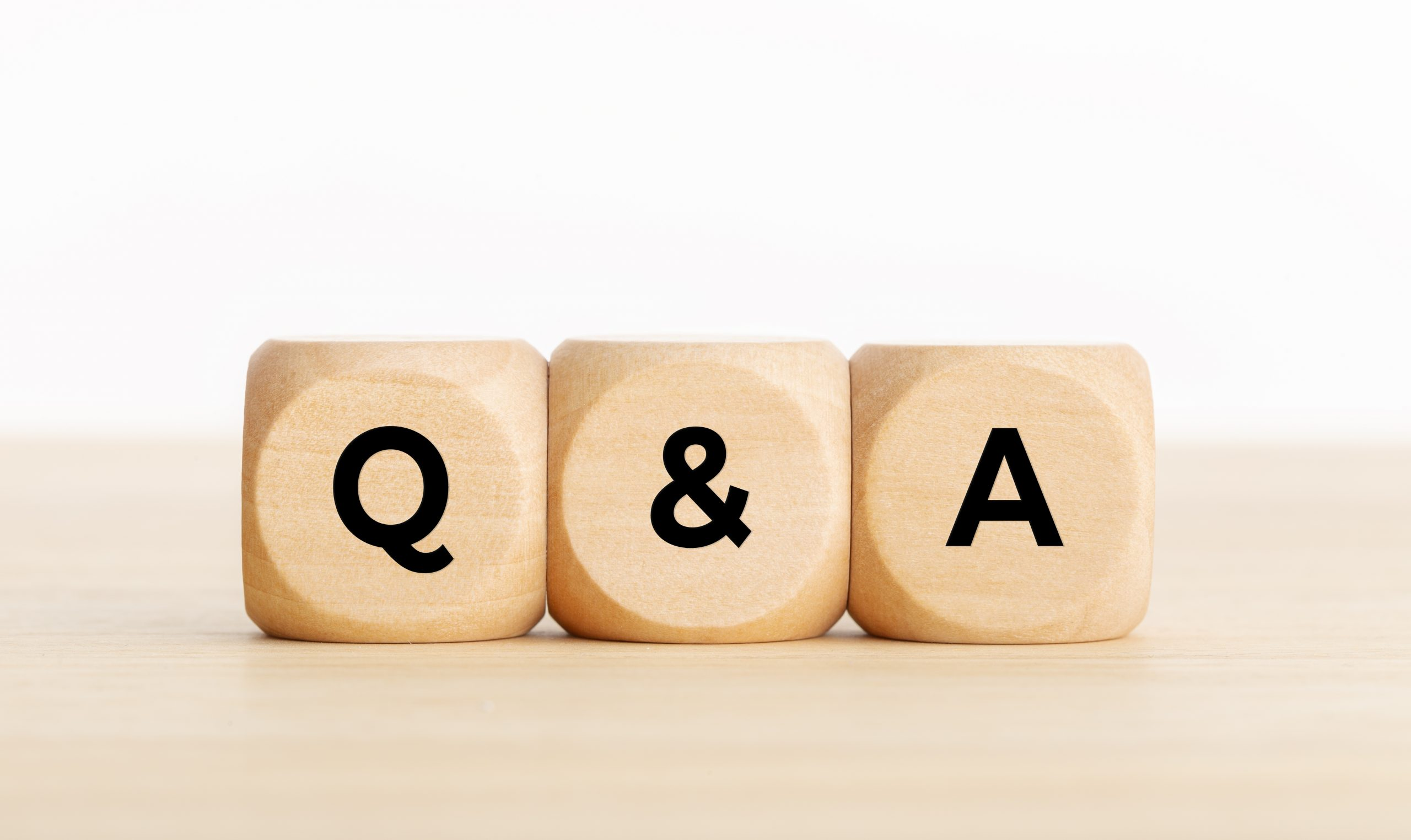"building blocks with ""q and a"" written on them"